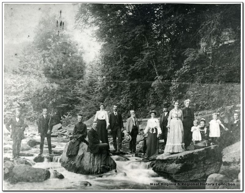 Guests of the Webster Springs Hotel visit the Elk River behind where the hotel stood.