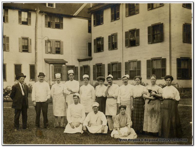 Staff from the Webster Springs Hotel stand in front of the building.