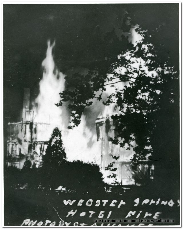 The Webster Springs Hotel as it burns down, engulfed in flames.