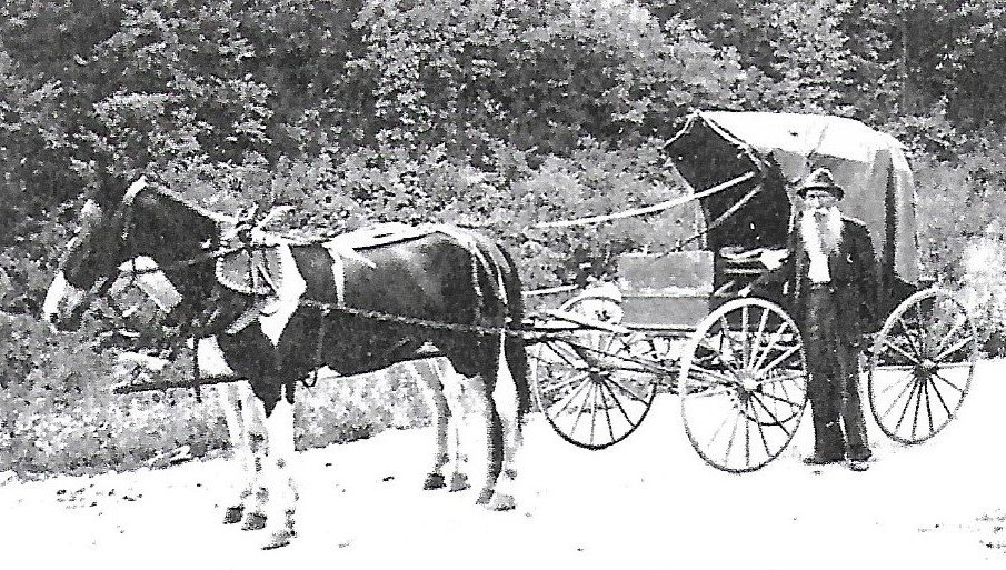 Dr. McClellan's father, Rev. Robert E. McClellan hauling mail on his route. (Courtesy of Lottie Midkiff)