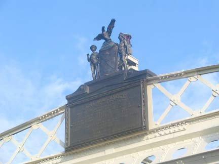 Statue Over Bridge