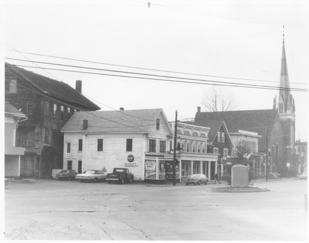 South Side of Main Street incl. Coop Gristmill, Copp Mill 3, Meserve's Store, Copp Block, Page Blick, Bryant and Lawrence, Inc., and the Trinity Church by Roger P. Akeley on December 15, 1982