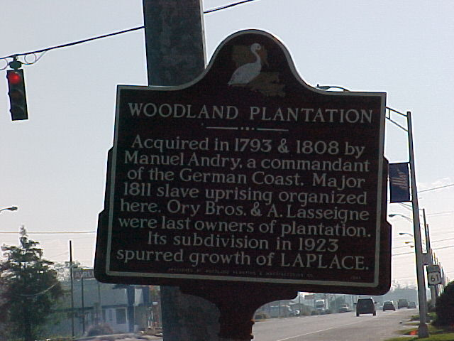 """Historical marker for the Woodland Plantation that mentions slave revolt in one line that reads """"Major 1811 slave uprising organized here."""""""