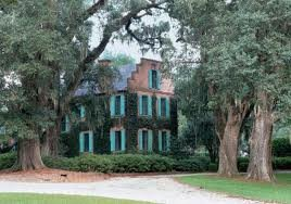 Sideview of the Medway Plantation sorrounded by trees.