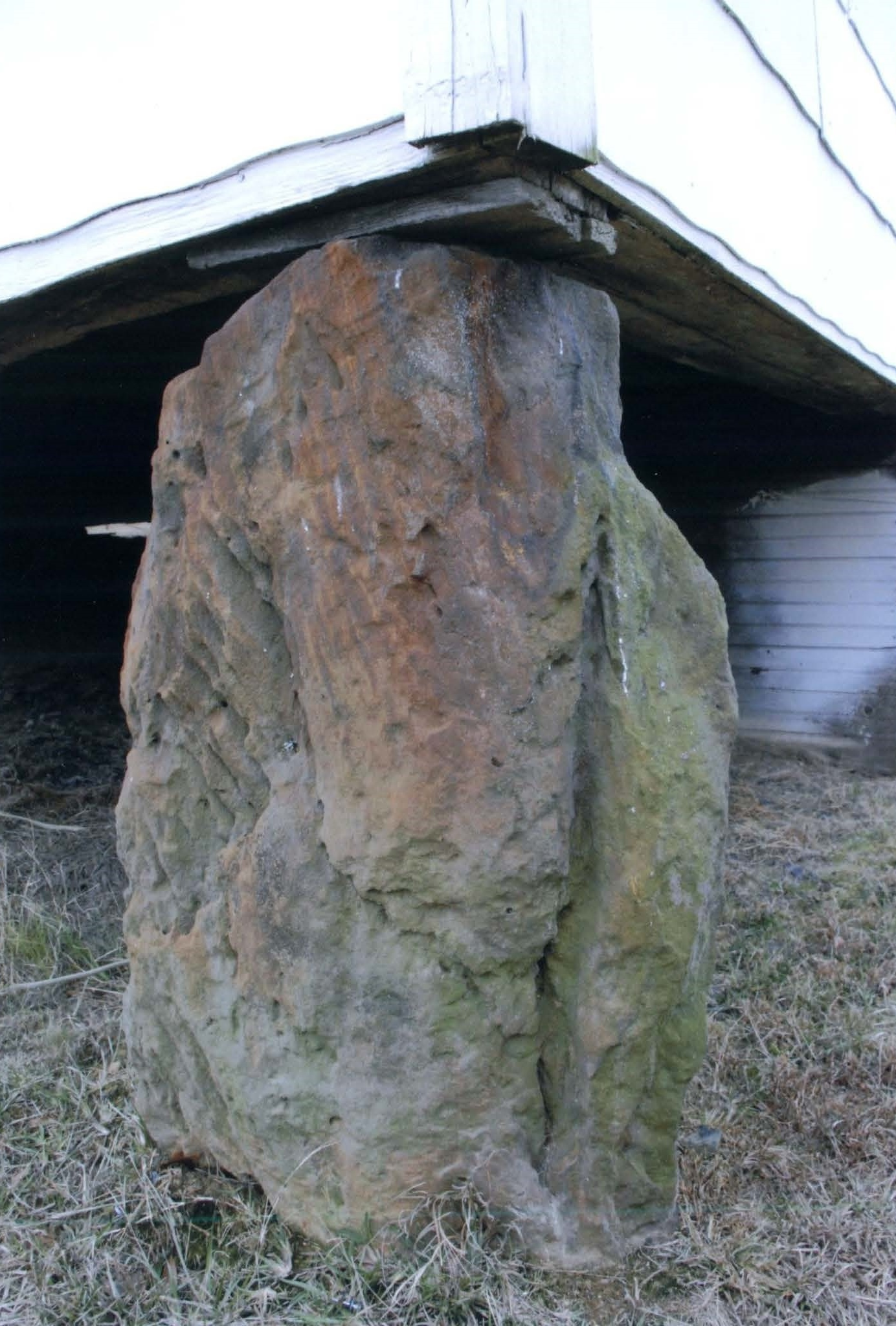 One of the boulders that the building rests one.