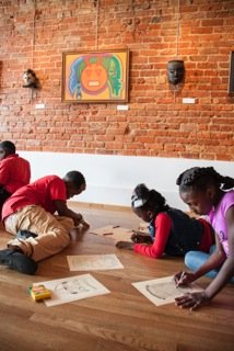Children making their own works of art at the Paul R. Jones gallery. University of Alabama Photography