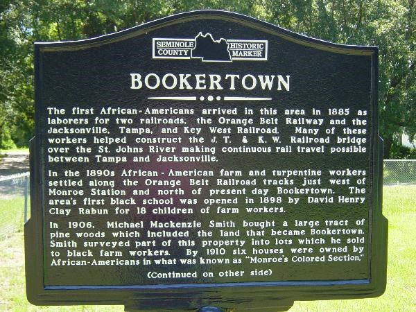 The marker, front side, relating details of the story of the area it commemorates.