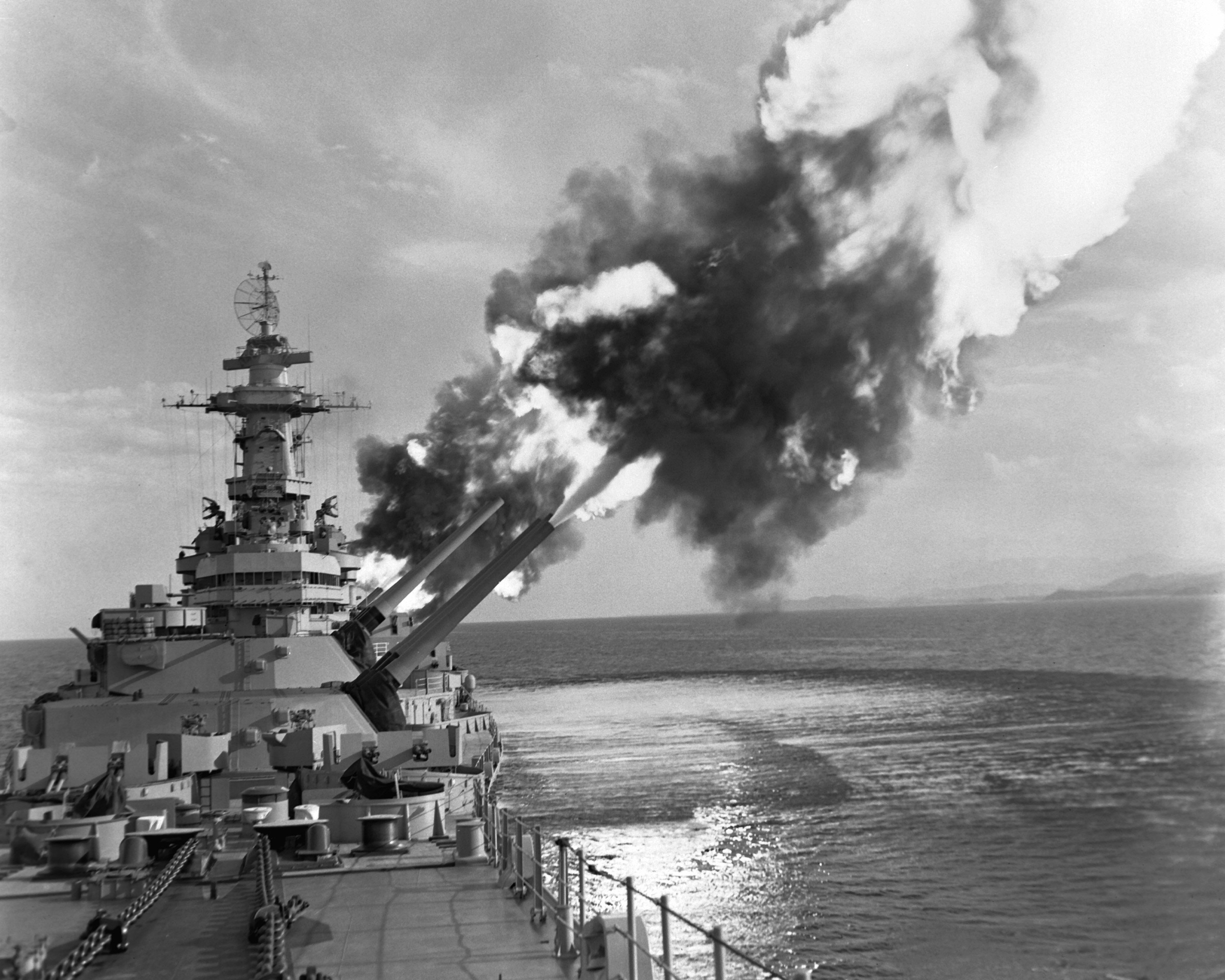 The USS New Jersey launching an artillery bombardment in Korea, 1953. (Wikimedia)