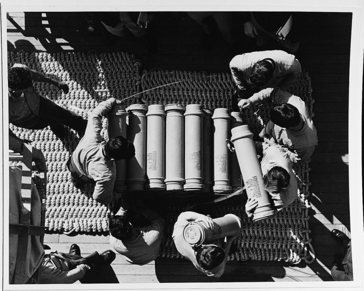 "Sailors stowing powder cans for the 5"" guns of USS New Jersey's secondary battery, 1968. Unlike her sister Iowa-class battleships, New Jersey served through the Vietnam War. (NHHC)"