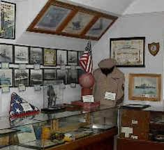The museum features numerous items on display including uniforms and photographs.
