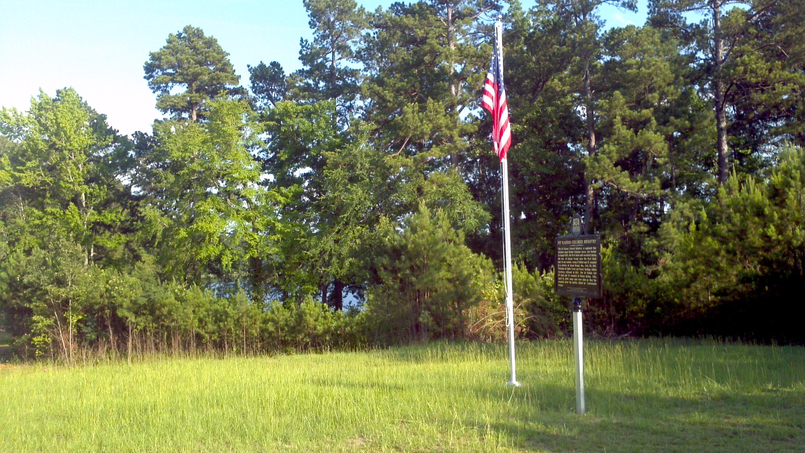 The marker is located near a single American flag that honors the Union soldiers who brought Arkansas back into the nation.