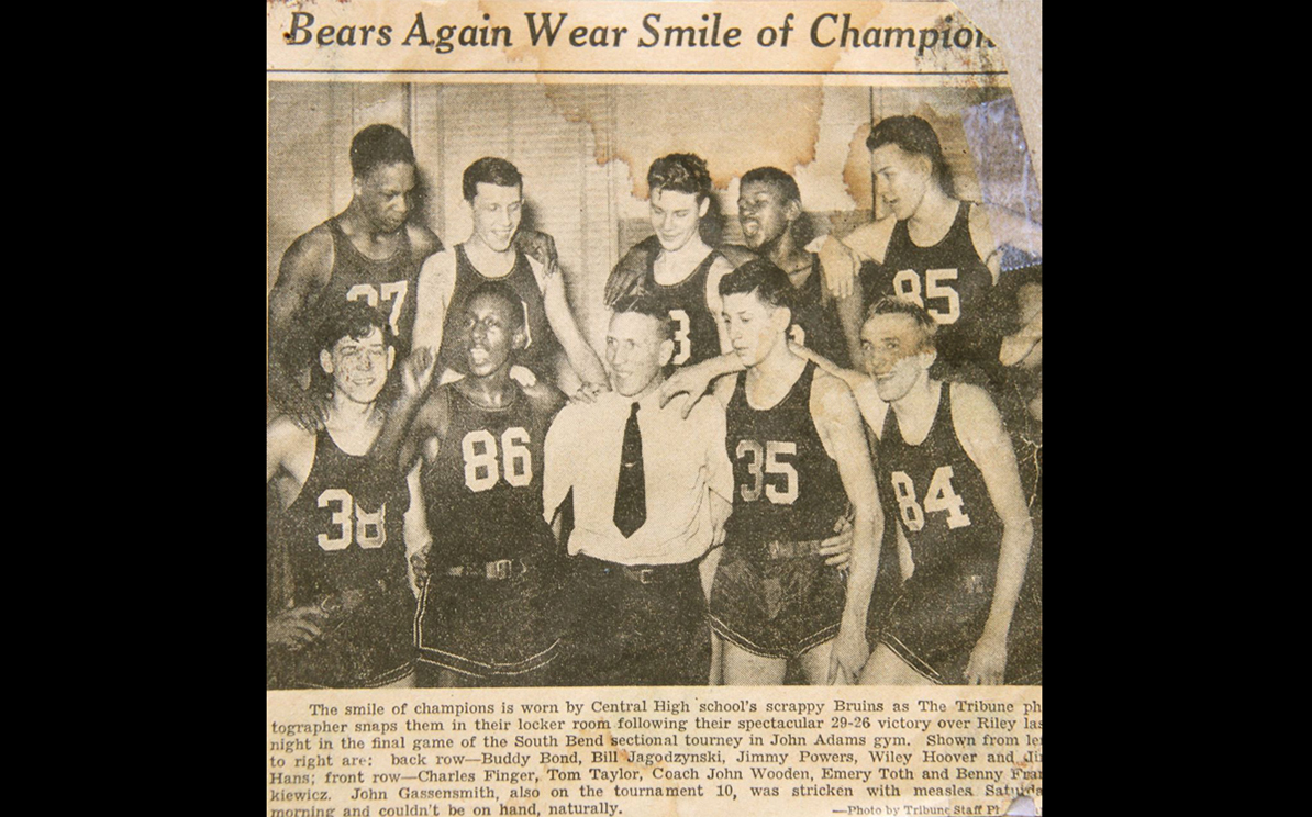 John Wooden with his team after winning a huge game in 1941