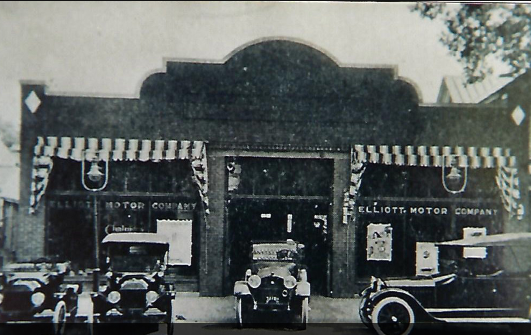 A century-old photograph of the building when it was a car dealership (courtesy of the Suffolk-Nansemond Historical Society, via The Virginian-Pilot). See FN for the original source.