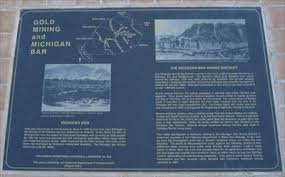 This marker was dedicated in 2001 and includes a photo of hydraulic mining in the 1860s near the site of the marker.