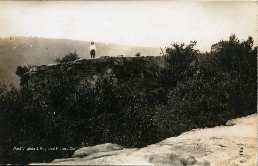 A lone figure standing on the overlook, undated but before 1936