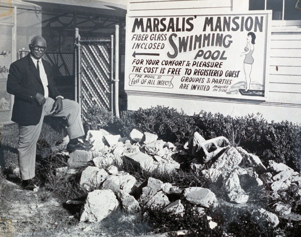 Ellis Marsallis Sr strikes a pose in front of the motel's pool sign.