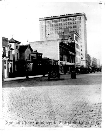 4th Ave looking west, with the bank in the background, circa 1925