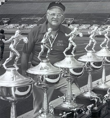 Woody Hayes with five Big 10 trophies in 1977