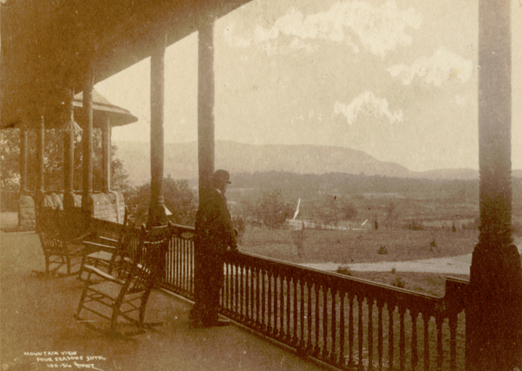 A visitor stares off to the South in this early picture from the building.
