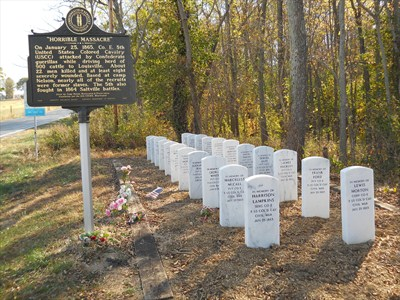 This historical marker and twenty-two gravestones honor the USCT soldiers who were buried in a mass grave.