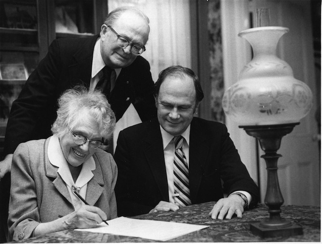 Alice Whittier signs the deed donating the Skolfield-Whittier House to the Pejepscot Historical Society in 1982. On the right are Orville Ranger, the lawyer, and Bert Whitman, the representative for the Society.
