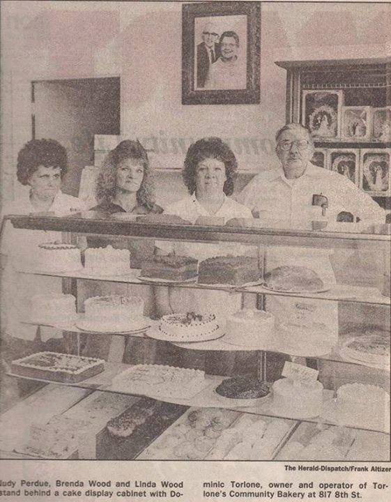 Dominic Torlone and staff behind the counter