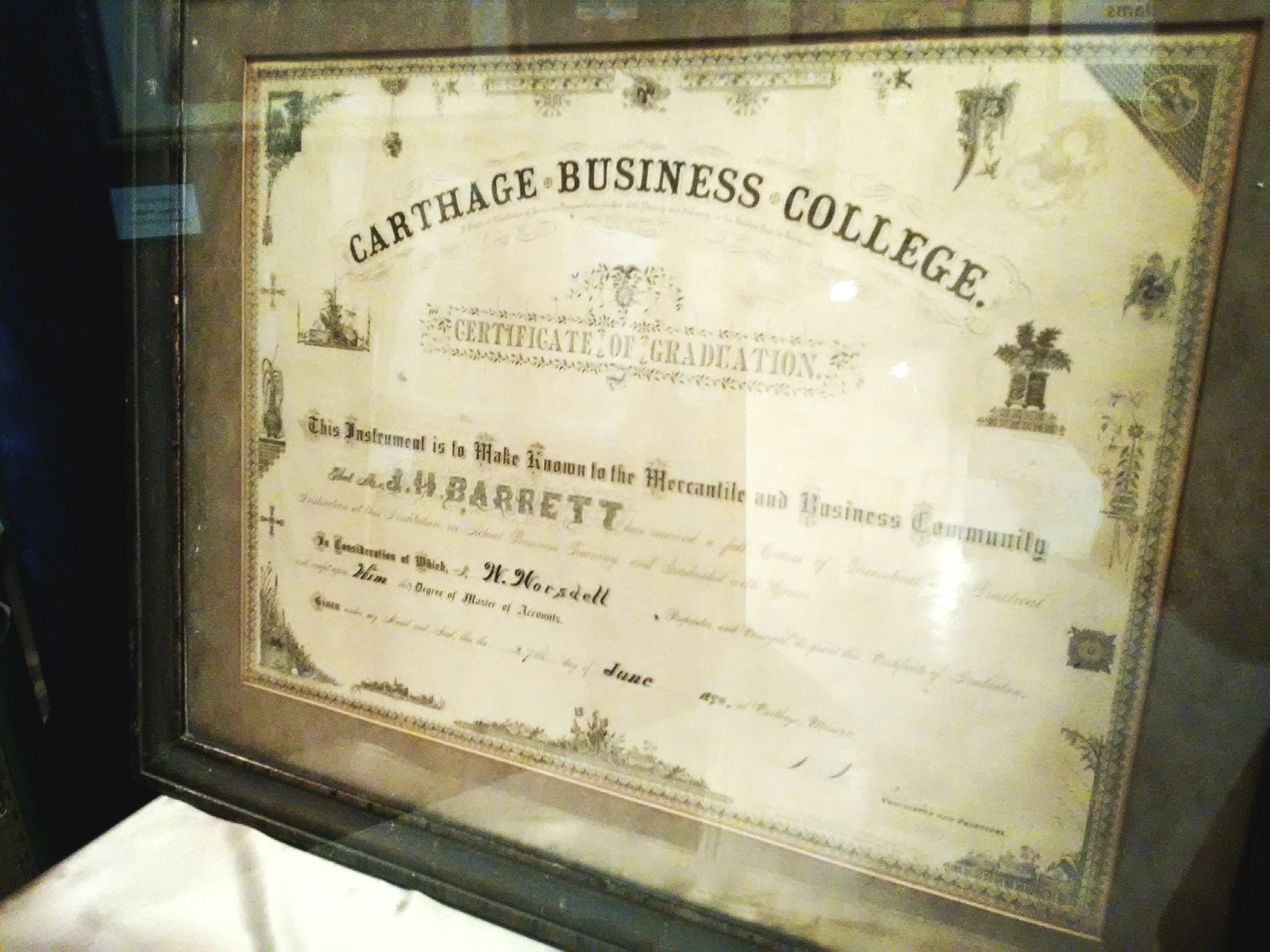 1890 Graduation certificate from Carthage Business College as displayed in the 175th Anniversary of Carthage Exhibit at Powers Museum in 2017. Certificate was awarded to J. H. Barratt by W. Worsdell, Proprietor of the college.
