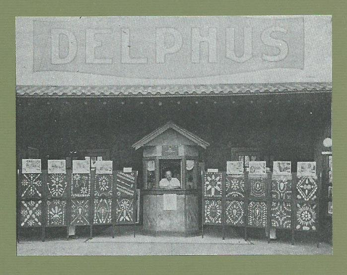 Delphus Theatre entrance on first floor of Cassaday Building. Ulrick Williams is at ticket booth along with George Williams' arrowhead collection. Both were sons of I.P. Williams, theater owner. Former exhibit Powers Museum exhibit mount is undated.