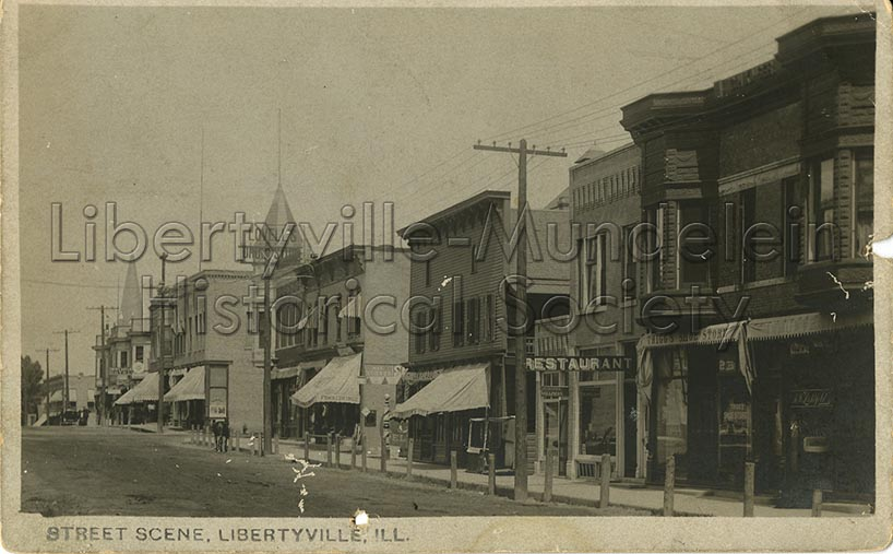 Milwaukee Ave. Looking North, Hanby Block is second from right, 1905-1911.