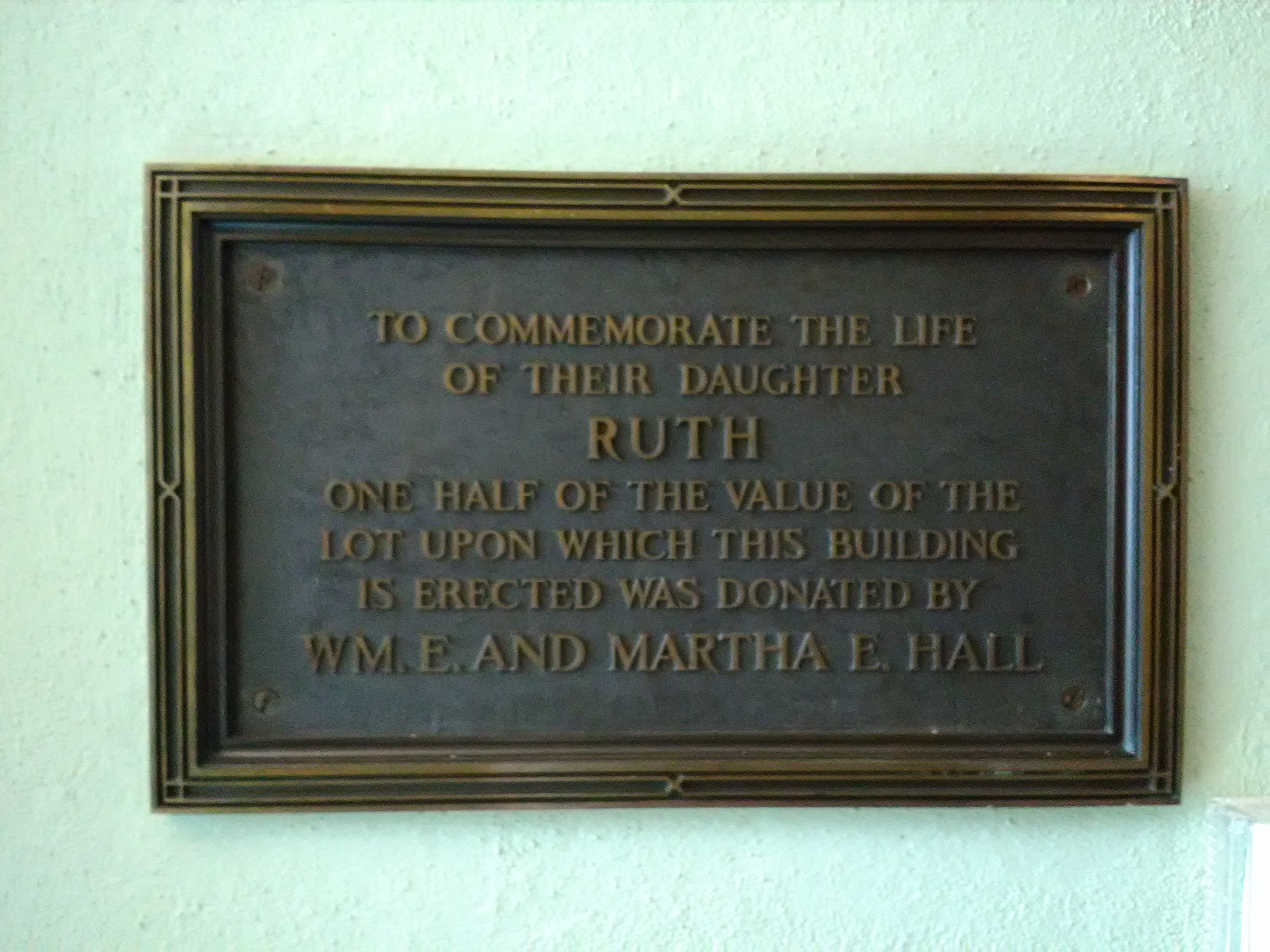 Marker inside the library in the 1905 portion honoring Ruth Hall.