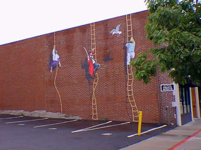 Exterior wall of the museum, which shows several pirates climbing the wall  (Photo courtesy of the New England Pirate Museum)
