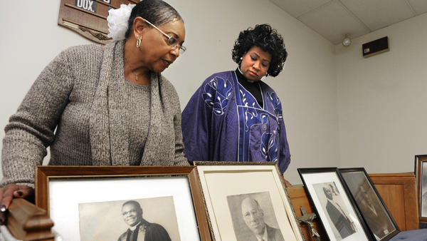 The upper sanctuary on the third floor of Asbury United Methodist Church features artifacts and documents. In this photo, church historian Gloria Brown (left) and Dr. Carletta Allen, pastor, look at portraits of former pastors.