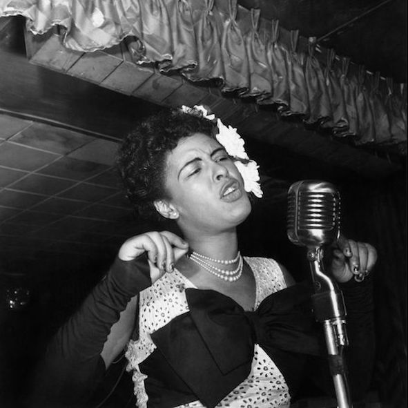 Billie Holiday singing at the Downbeat club (1947).