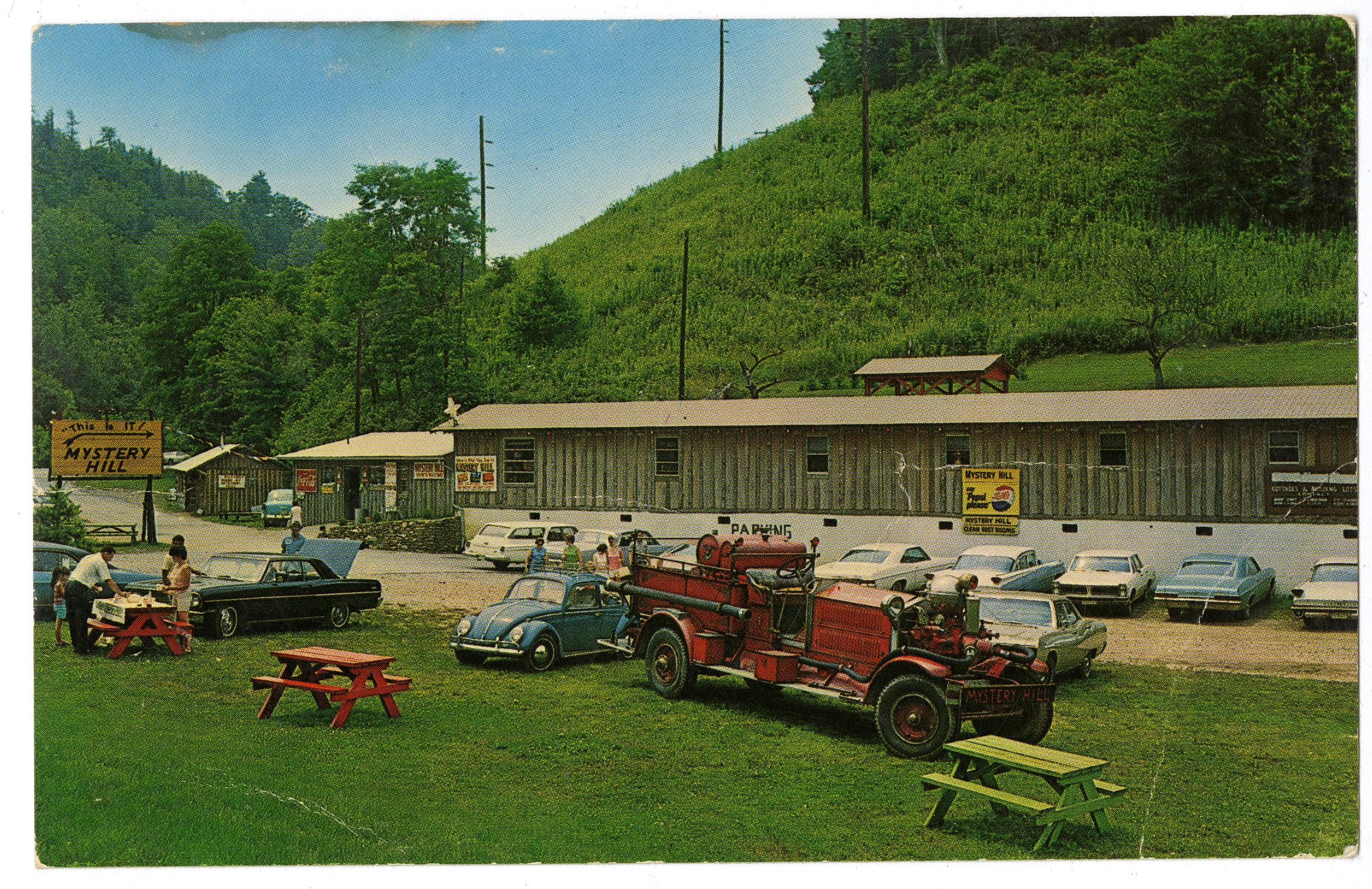 A postcard from Mystery Hill illustrating motorist families that flocked to the roadside attraction. 