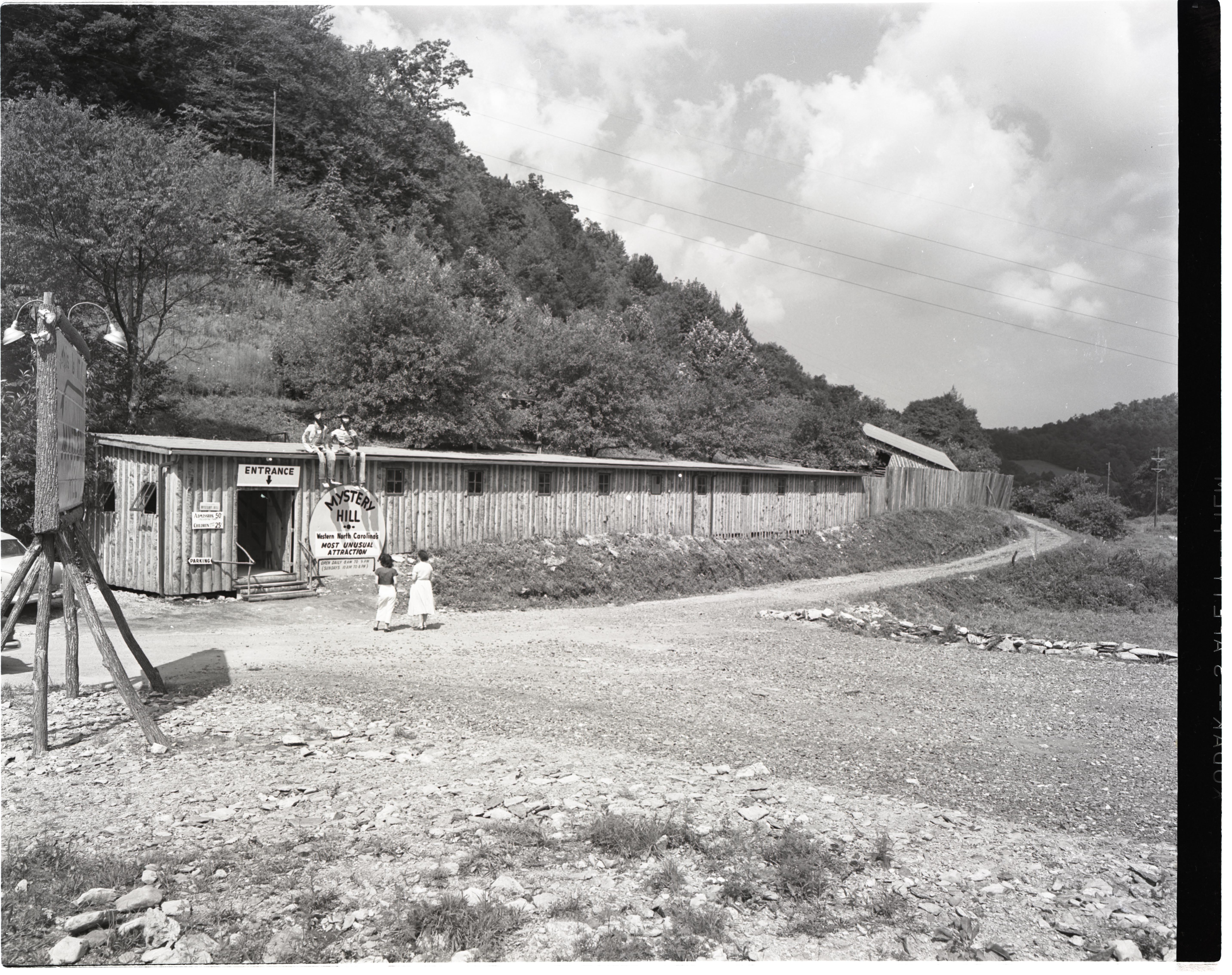 """Two women walking up to Mystery Hill circa. 1955. Admission at this time was a mere 50 cents for adults and 25 cents for children!  """"Two Women at Mystery Hill, 1955,"""" Digital Watauga, accessed October 17, 2017, http://digitalwatauga.org/items/sho"""