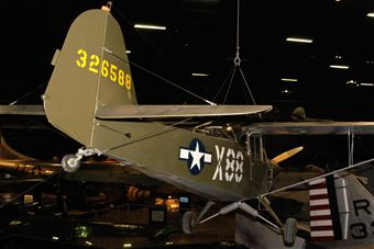 "The ""Grasshopper"" is one of many aircraft on display."