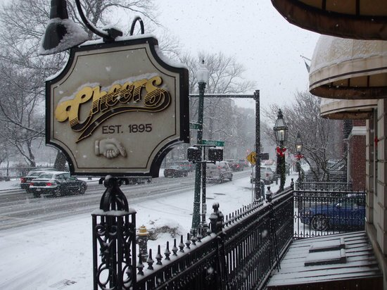 The iconic Cheers signage on a snowy day. The bar was originally known as the Bull and Finch Pub.