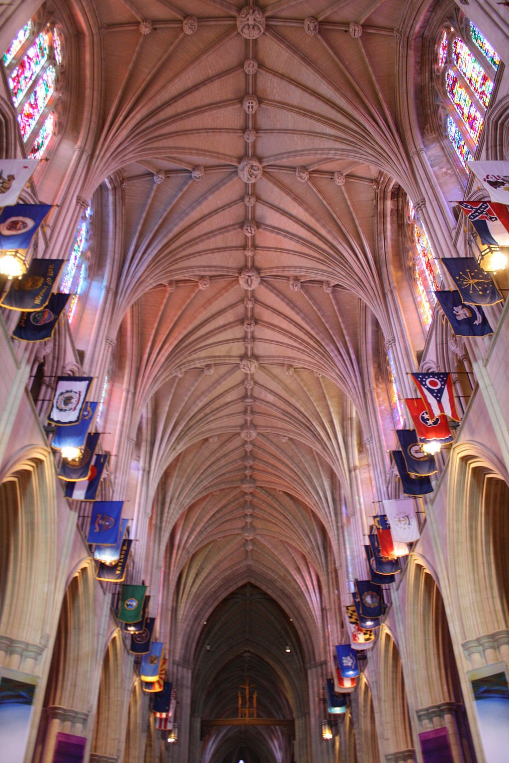 State flags hang from the nave of the Cathedral. Photo by Mina Elias, Wikimedia.