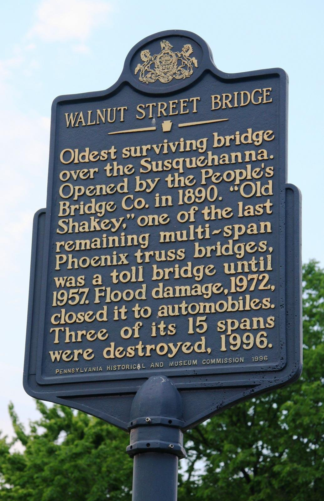 The historical marker that stands near the Walnut Street Bridge.