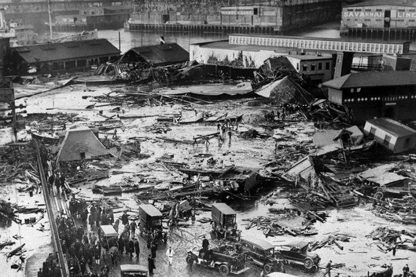 The ruins left after the 2.3 million gallon tank of molasses exploded and ravaged part of the city of Boston. 