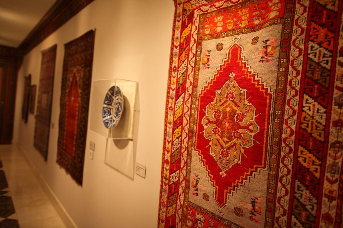 Prayer rugs on display in the gallery