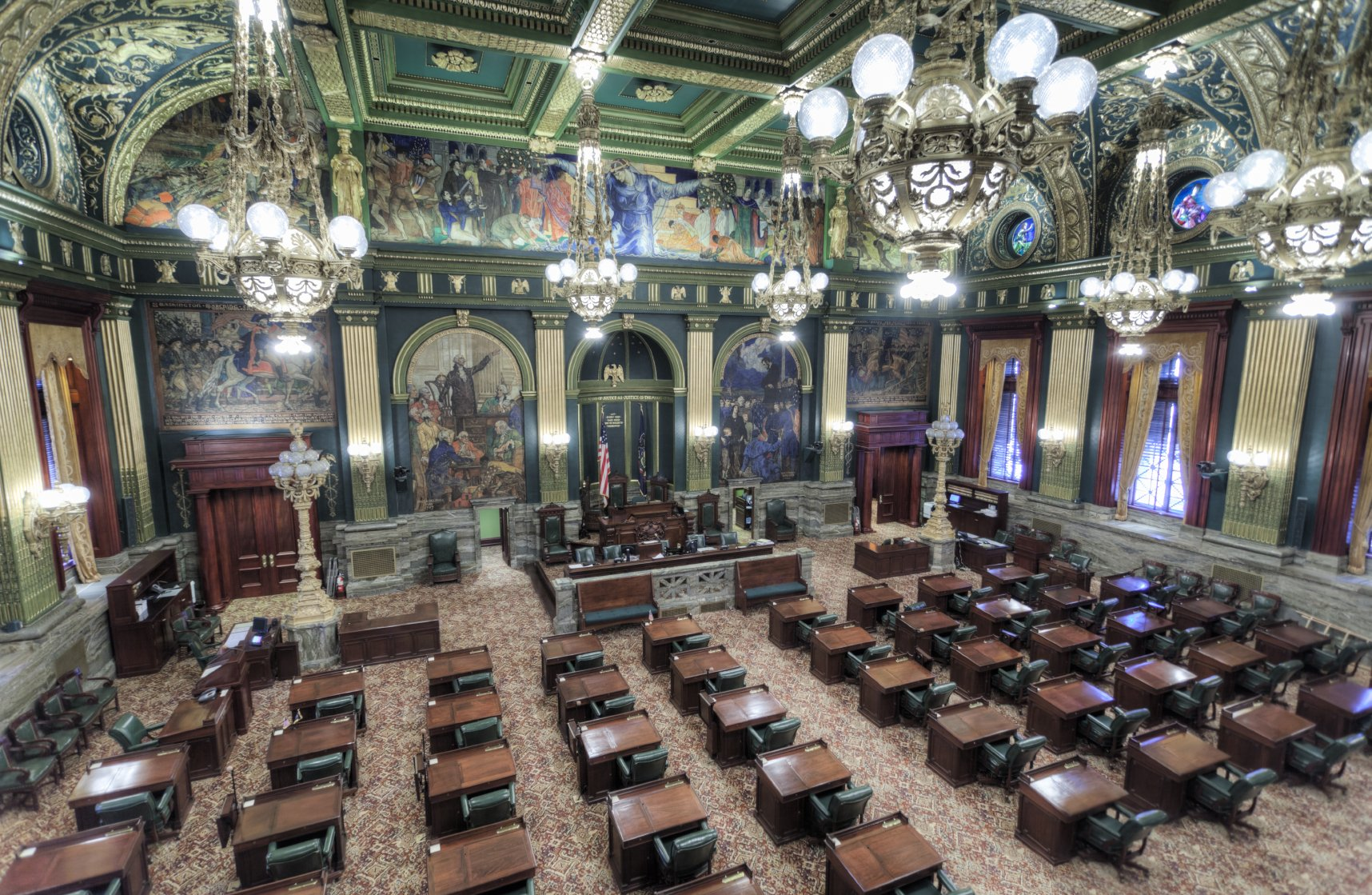 The ornate Senate chamber features murals by Violet Oakley...