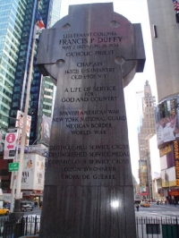 The inscription on the back of the monument includes his military service and his service to New York City.