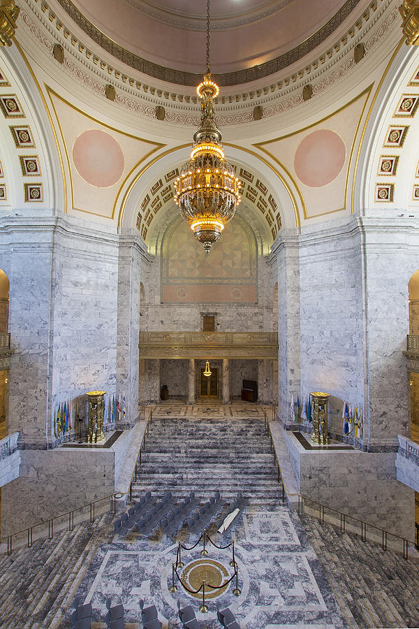 The 10,000 pound Tiffany chandelier hangs above the Washington state seal