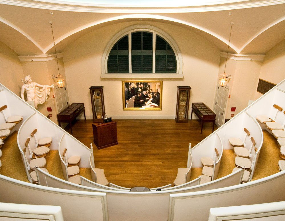 The inside of the Ether Dome includes seating for audiences and students, the mummy Padihershef on display, and an oil painting depicting the surgery commissioned by Massachusetts General Hospital in 2000.