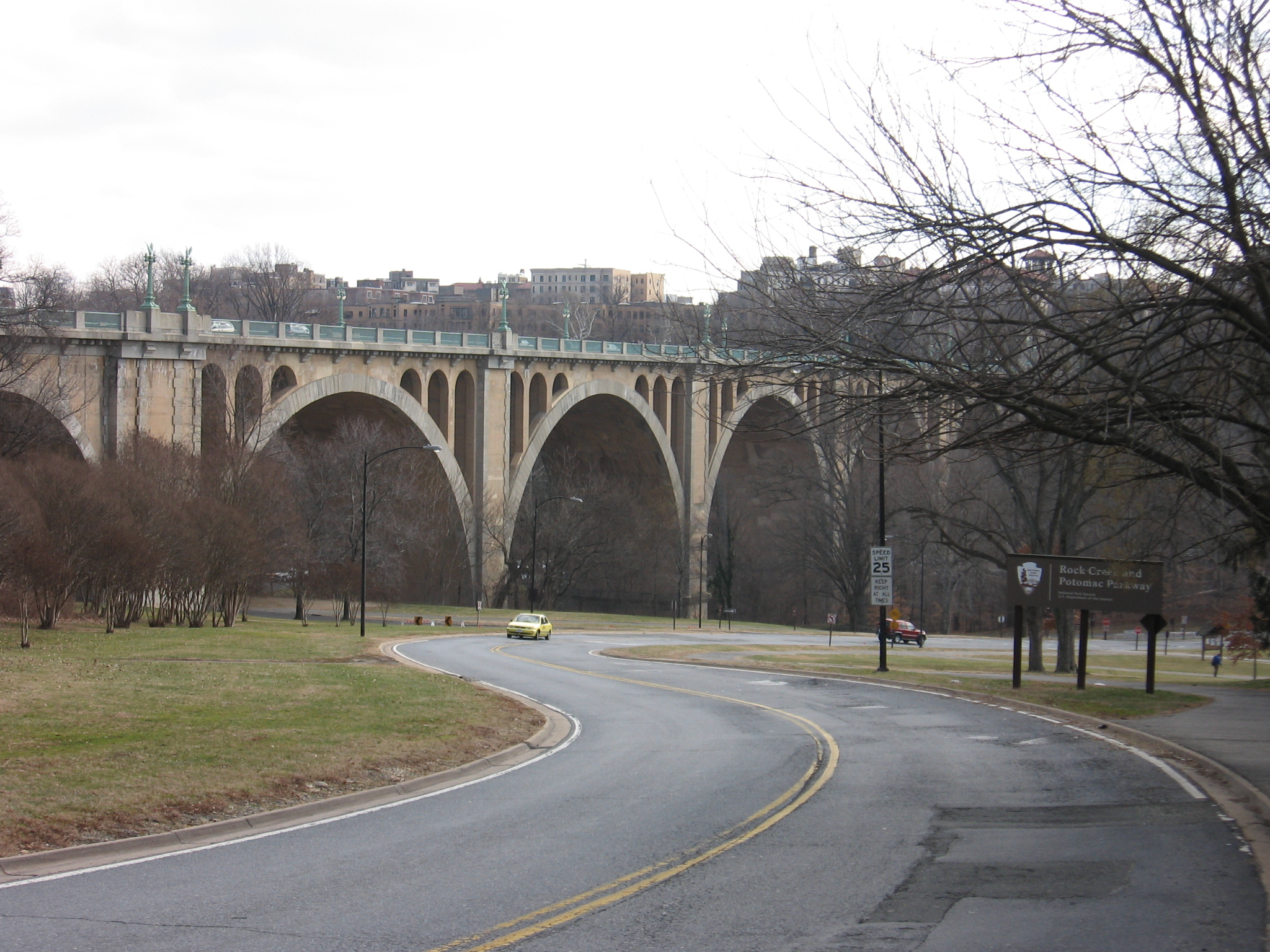 The Taft Bridge connects two neighborhoods separated by Rock Creek Park. Its arches are reminiscent of a Roman aqueduct. Photo by Michiel1972, Wikimedia.