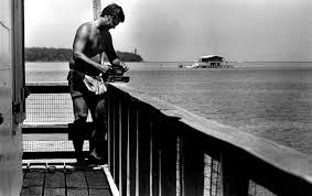 A fisherman fishing off Stiltsville back in the day.