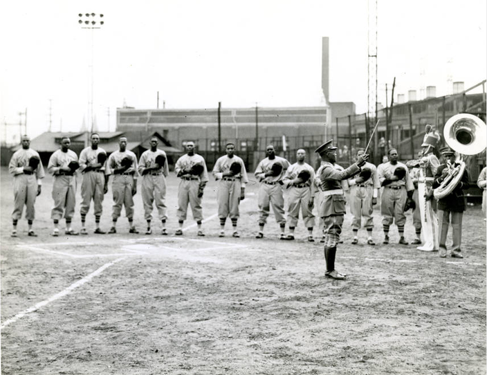 A band performs the Star Spangled Banner prior to the start of a 1940s Philadelphia Stars game at Penmar Park
