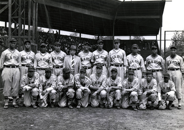 1944 team photo of the Philadelphia Stars. Behind the team is the famous grandstand from which Miss Hattie Williams obtained her firewood