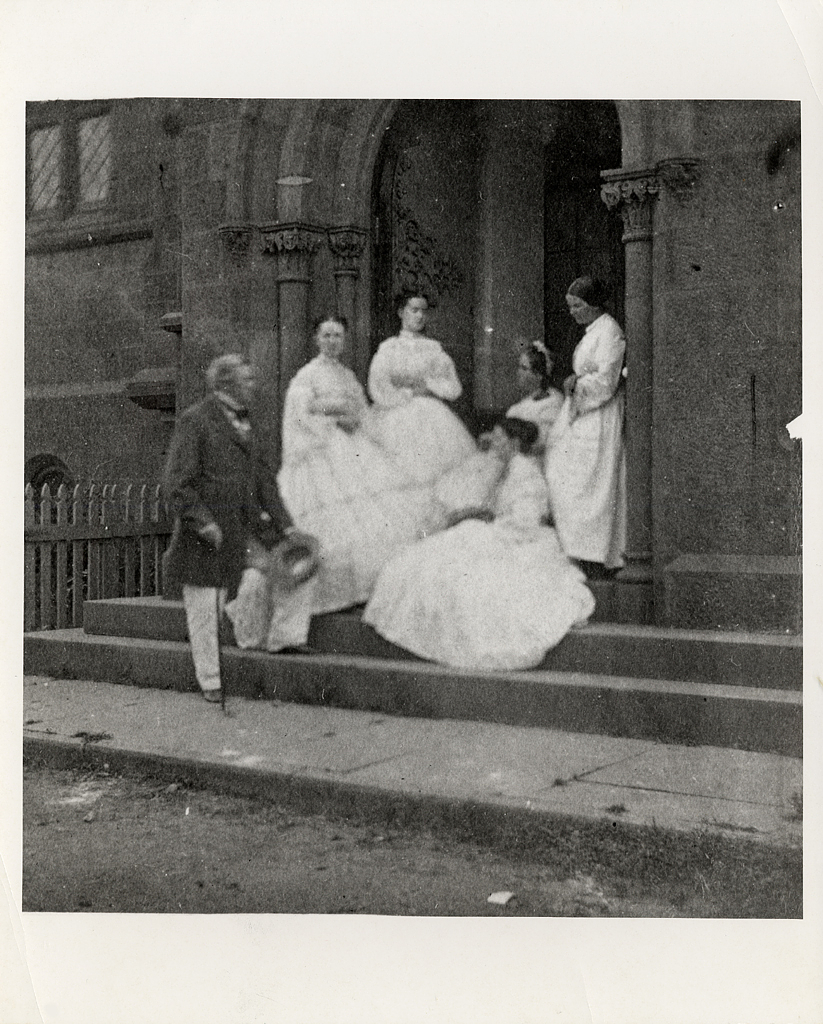 Henry, his wife Harriet, and three of their four children, Caroline, Mary and Helen, standing in the east doorway to the Castle. Courtesy of the Smithsonian Institution Archives.